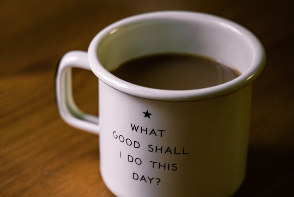 "mug with writing on saying ""what good shall I do this day?"""